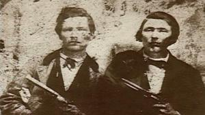 Frank and Jesse James with their revolvers. They would follow in the Reno tradition and became skilled train robbers.