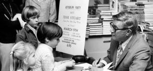 Jesse Stuart as an older man with young readers. Photo credit: Jesse Stuart Foundation Pinterest page.