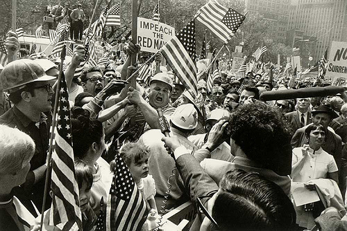 "Confrontation between ""hard hats""--American construction workers--and protesters during the 1960s."