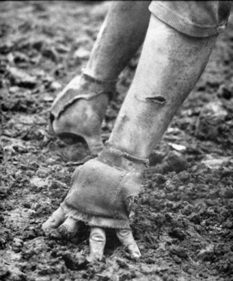 One of the gritty photos of a lineman's gloved hands that appeared in the Life Magazine story on Martin's Ferry football in the early 1960s. Photo: LIfe Magazine/Ohio Valley Athletics